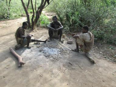 Hadzabe men sit around after their hunt. The tribe is completely nomadic, and lives off the land. There are only 600 members of the tribe left.  Photo by: Gary Kerr